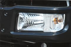 Clear lens wraparound head lamp for superior visibility, coupled with chic styling