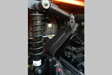 Improved cabin suspension with front dampers and rear shock absorbers with coil spring